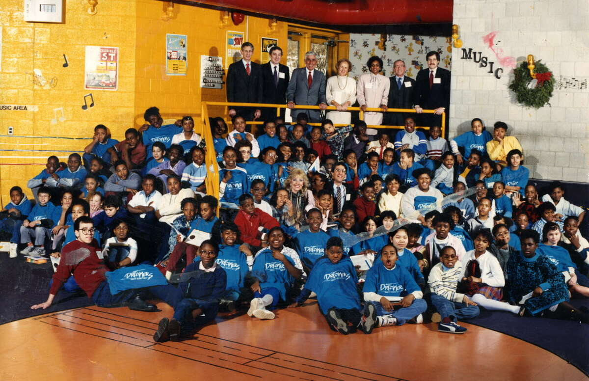 Photo of the sixth-grade class of Dreamers at Arbor Hill Elementary. Top left is benefactor Richard Yulman, and his wife is in the center of the children. the program was Donald Ivy. Among the children who earned college scholarships was Donald ?Dontay? Ivy, who died after being shocked with a stun gun in a struggle with Albany police on April 22, 2015. (Photo Courtesy of Nakia Tillman)