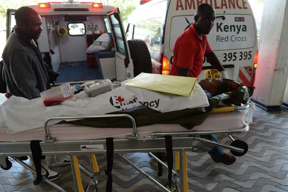 A victim of the attack on Garissa University College on Thursday in Kenya is wheeled into a Nairobi hospital. Most of the 147 dead in the attack were students. Photo: SIMON MAINA, Stringer / AFP
