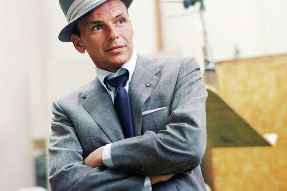 Frank Sinatra, shown at a Capitol Records session in Los Angeles in 1954, Frank Sinatra at a Capitol Records recording session in Los Angeles, CA. 1954. © 1978 Sid Avery