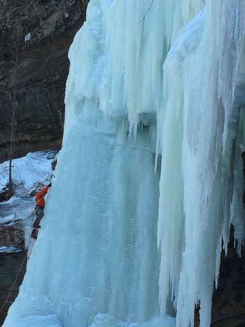 "Dwight Cheu and Brendan Kirby climbed Kaaterskill Falls this season. The falls require sustained cold to freeze over, and even last year didn't fully form. ""So when it did come into full shape this year, we knew we had to climb it,"" Cheu said. Kirby, the climber shown, describes it in his Facebook post: With windchills at brutal - 20 degrees this morning we set out to take on the biggest and by far scariest waterfall in the ?#?Catskill? Park. ""I can safely say we put in some serious work today to manage this one. After freezing hands and feet, booming sounds of ice shifting and falling, 2 pitches, and multiple lead swaps we managed to top out on the overhanging upper falls pitch."""