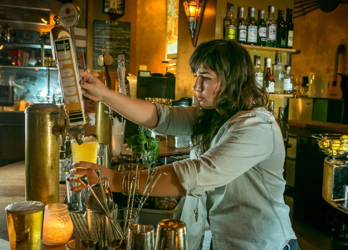 Bartender Dani Brierly pours a beer at the Orbit Room in San Francisco, Calif., on November 4th, 2013.