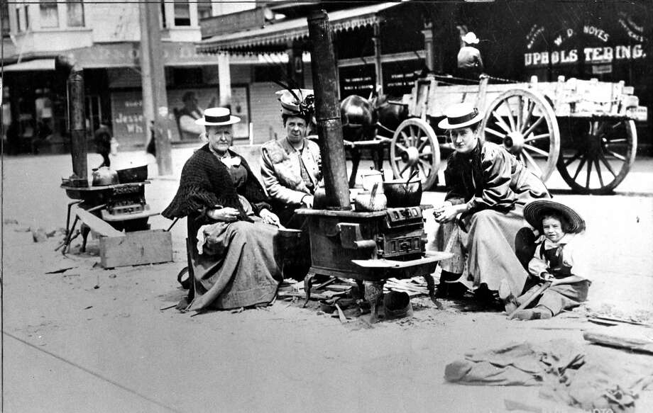 1906 earthquake photo from The San Francisco Chronicle archive. Photographer unknown. Three women and a child cooking in the street because of a fire hazard. Photo: Chronicle Archives