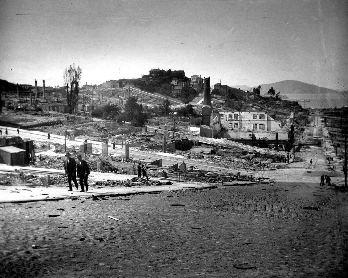 1906 earthquake photo from The San Francisco Chronicle archive. Photographer unknown. Looking down at Russian Hill, cable car barn and Washington and Mason streets.