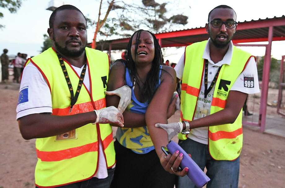 Paramedics help a student who was injured during an attack by Somalia's al-Qaida-linked al-Shabab gunmen on the Garissa University College campus in eastern Kenya. Photo: Carl De Souza /Getty Images / AFP