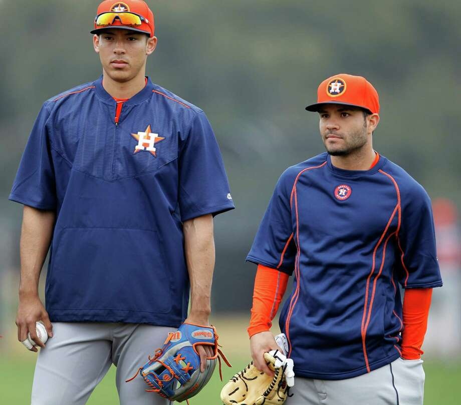 Maybe as early as this season, the middle of the infield for the Astros will feature Carlos Correa, left, at shortstop and AL batting champ Jose Altuve at second base. Photo: Karen Warren, Staff / © 2015 Houston Chronicle