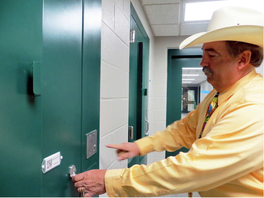 "Gillespie County Sheriff Buddy Mills said he's ""very, very happy"" with the new jail (he's shown touring it (4-1-15) and should move county inmates into it later this month. Photo: Zeke MacCormack, San Antonio Express-News"
