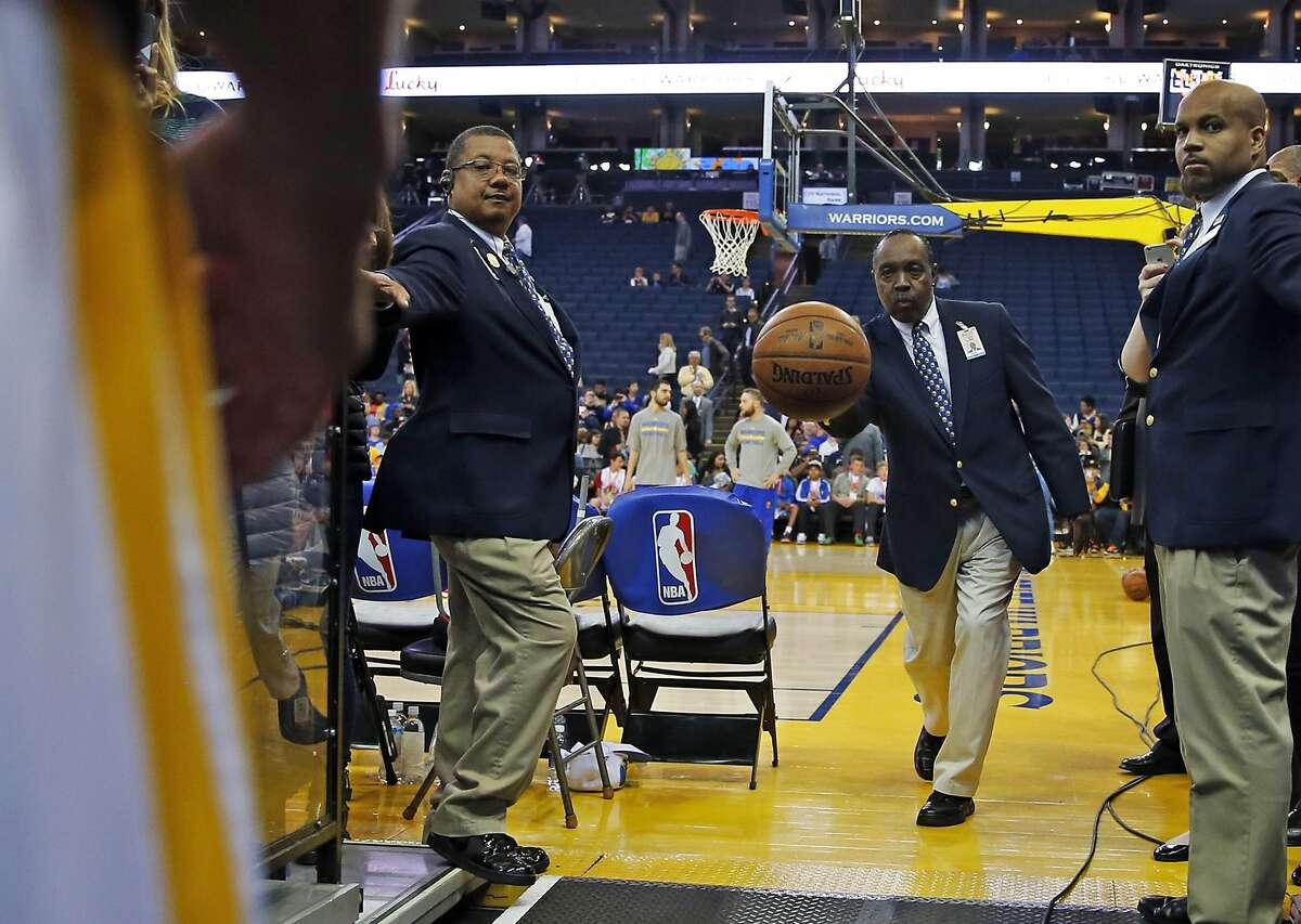 Oracle Arena Security Guard Curtis Jones tosses a ball to Golden State Warriors' Stephen Curry, so, Curry can shoot from the tunnel as part of his pre-game ritual before playing Phoenix Suns during NBA game in Oakland, Calif., on Thursday, April 2, 2015.