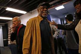 Actor Danny Glover talks with a friend before Golden State Warriors play Phoenix Suns in NBA game at Oracle Arena in Oakland, Calif., on Thursday, April 2, 2015.