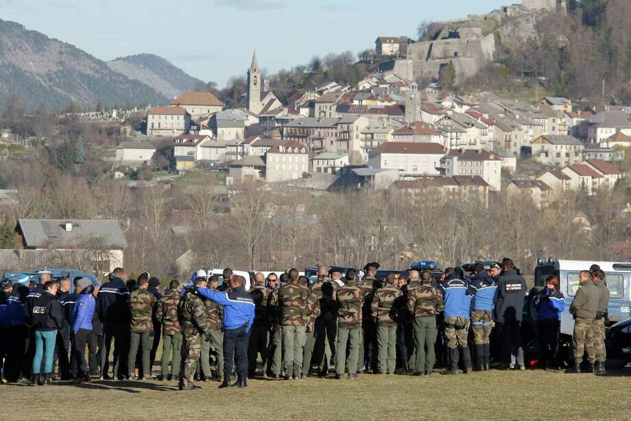 Mountain troops, police and gendarme officer  listen during a briefing before heading to the crash site, Thursday, April 2, 2015 in Seyne-les-Alpes, France. Investigators believe co-pilot Andreas Lubitz intentionally crashed the Germanwings A320 into a mountainside, based on recordings from the cockpit voice recorder, killing 150 people. Special mountain troops continued searching the area for personal belongings and the second black box flight recorder (AP Photo/Claude Paris) Photo: Claude Paris, STR / Associated Press / AP