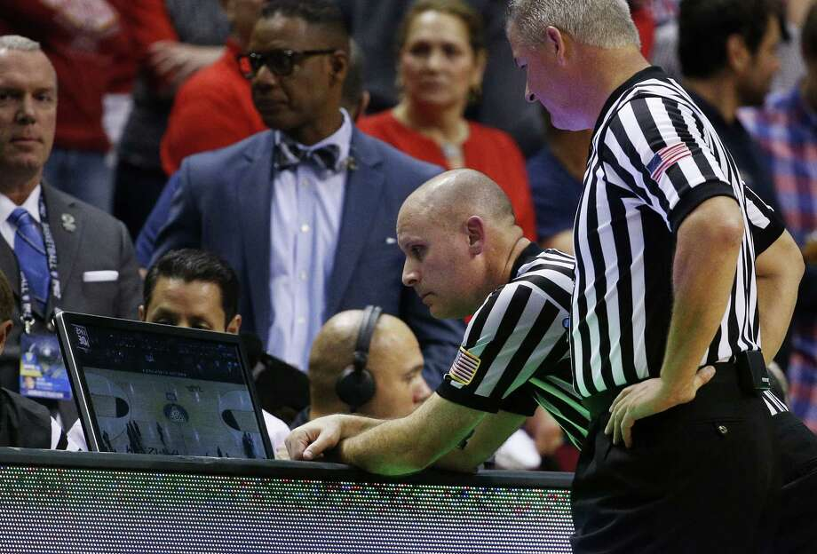 A flagrant foul in the NBA? Broadcasters and TV viewers have an opinion within seconds, but everyone must wait for the referees gathered around the scorers' table to become part of the decision. Photo: John Locher / Associated Press / AP