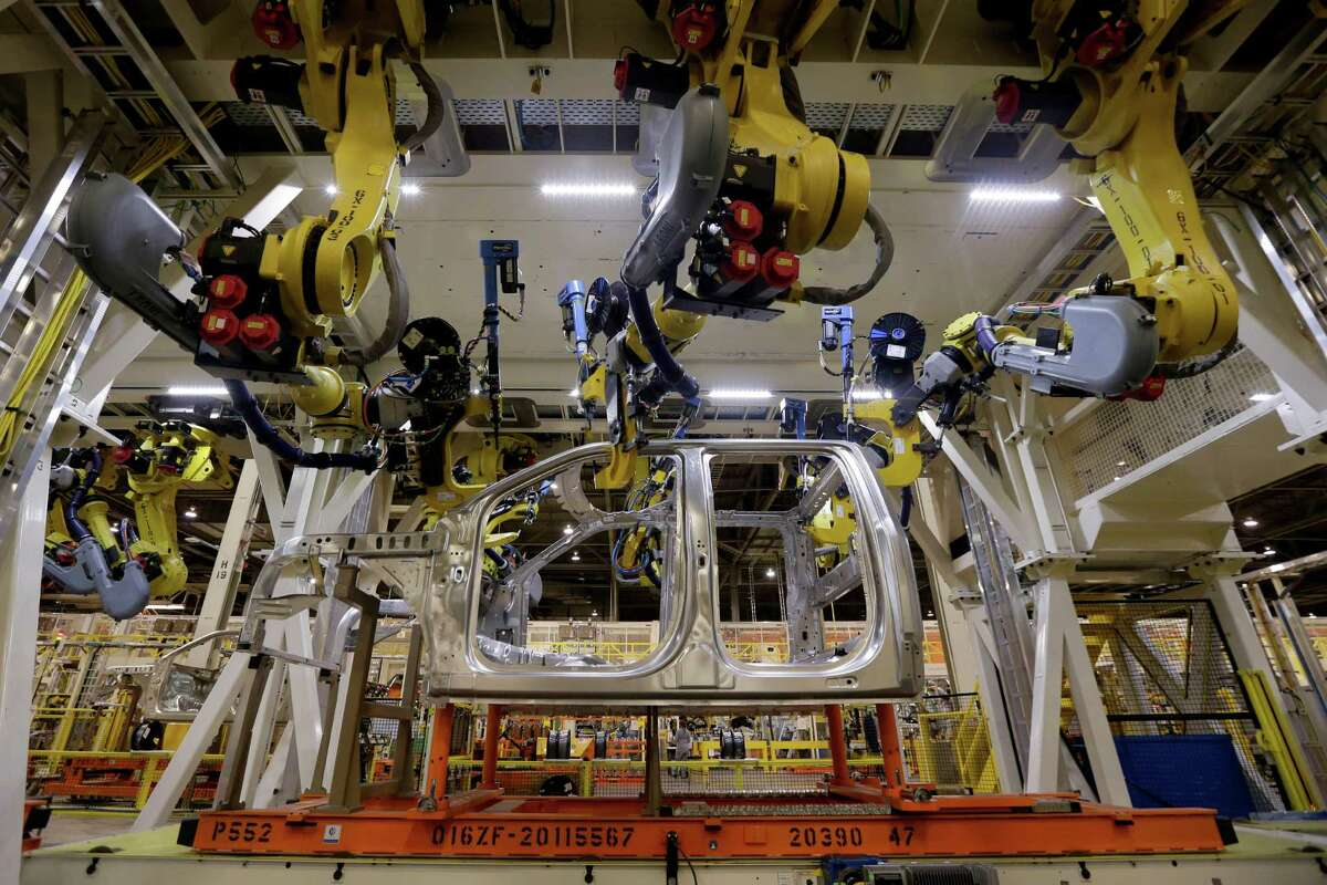 In this March 13, 2015 photo, robots fasten parts on a 2015 Ford F-150 truck at the company's assembly plant in Claycomo, Mo. >>Keep going for a look at what President-elect Donald Trump hopes to accomplish in his first 100 days.