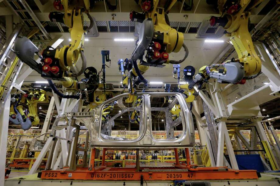 In this March 13, 2015 photo, robots fasten parts on a 2015 Ford F-150 truck at the company's assembly plant in Claycomo, Mo.>>Keep going for a look at what President-elect Donald Trump hopes to accomplish in his first 100 days. Photo: Charlie Riedel, STF / AP