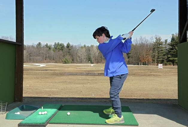 Rowan Healy, 10, who is here from Maryland visiting his grandparents, practices his golf swing at the Northway Golf Center driving range Thursday, April 2, 2015 in Clifton Park, N.Y.  (Lori Van Buren / Times Union) Photo: Lori Van Buren