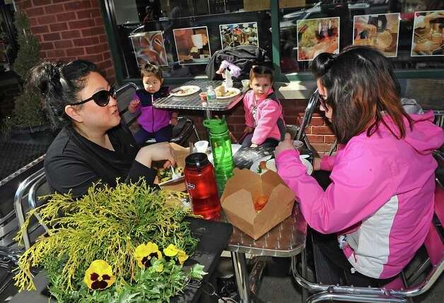 From left, Alyssa Duncan of Malta and her daughter Hailey Hutchens, 2, have lunch al fresco with Liz Peabody of Gansevoort and her daughter Amelia Correll, 4, at Putnam Market on Broadway Thursday, April 2, 2015 in Saratoga Springs, N.Y.  (Lori Van Buren / Times Union) Photo: Lori Van Buren