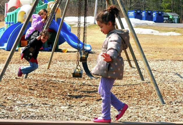 Four-year-old Janiya Thornton takes a walk on a balance beam during an outdoor recess at Colonie Community Day Care on Thursday April 2, 2015 in Colonie, N.Y. (Michael P. Farrell/Times Union) Photo: Michael P. Farrell