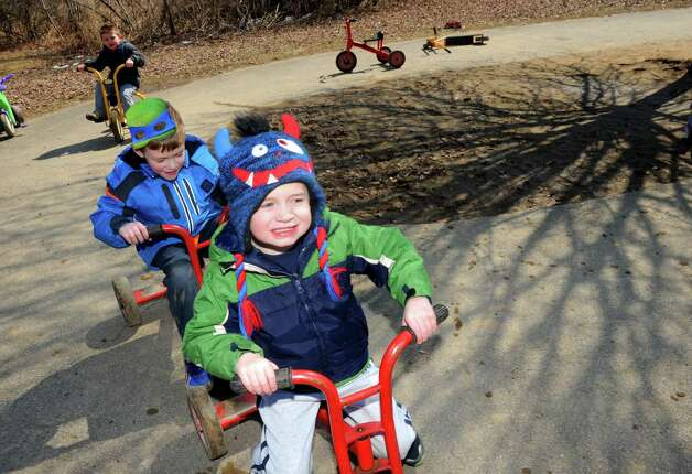 Five-year-old Sam Chamberlin leads the pack in a trike race during an outdoor recess at Colonie Community Day Care on Thursday April 2, 2015 in Colonie, N.Y. (Michael P. Farrell/Times Union) Photo: Michael P. Farrell