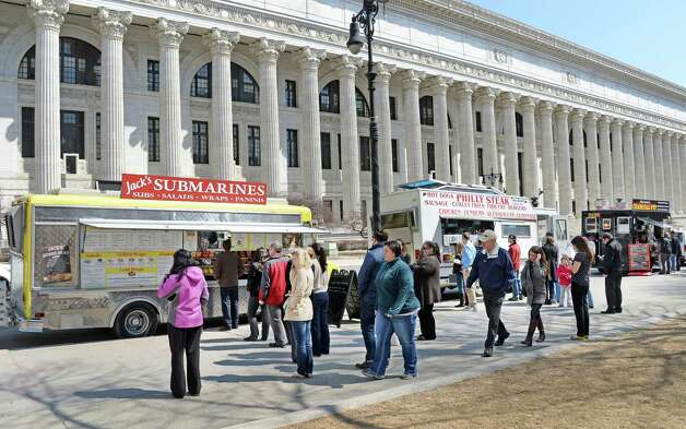 Food vendors and the lunchtime crowd take advantage of sunny spring weather at the Capitol Thursday April 2, 2015 in Albany, NY.   (John Carl D'Annibale / Times Union) Photo: John Carl D'Annibale