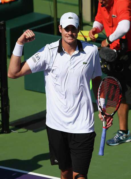 John Isner celebrates a 6-4, 6-3 victory over Kei Nishikori on Thursday, which advanced Isner to the semifinals of the Miami Open at Key Biscayne, Fla. Photo: Clive Brunskill, Staff / 2015 Getty Images