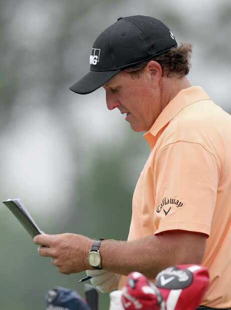 Phil Mickelson had to like what he saw on his scorecard Thursday after shooting a 6-under 66 that has the veteran golfer three shots out of the Shell Houston Open lead. Photo: Thomas B. Shea, Freelance / © 2015 Thomas B. Shea