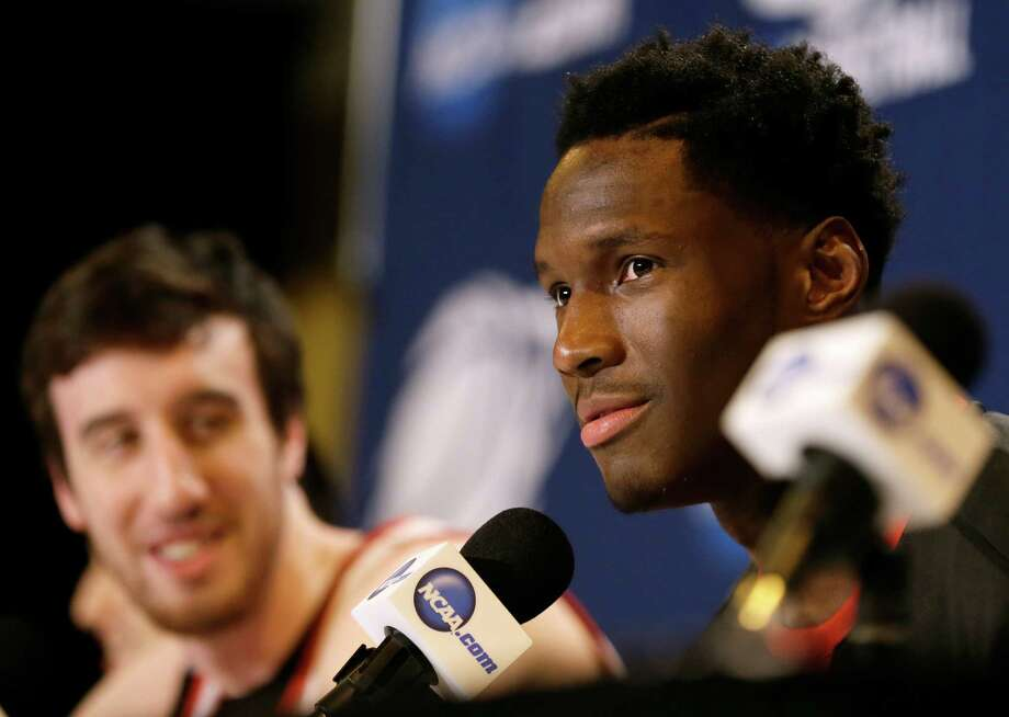 """With teammate and jokester Frank Kaminsky looking on, Wisconsin forward Nigel Hayes, right, proves he's up for a bit of fun at a news conference by using such words as """"cattywampus"""" and """"onomatopoeia."""" Photo: Charlie Neibergall, STF / AP"""