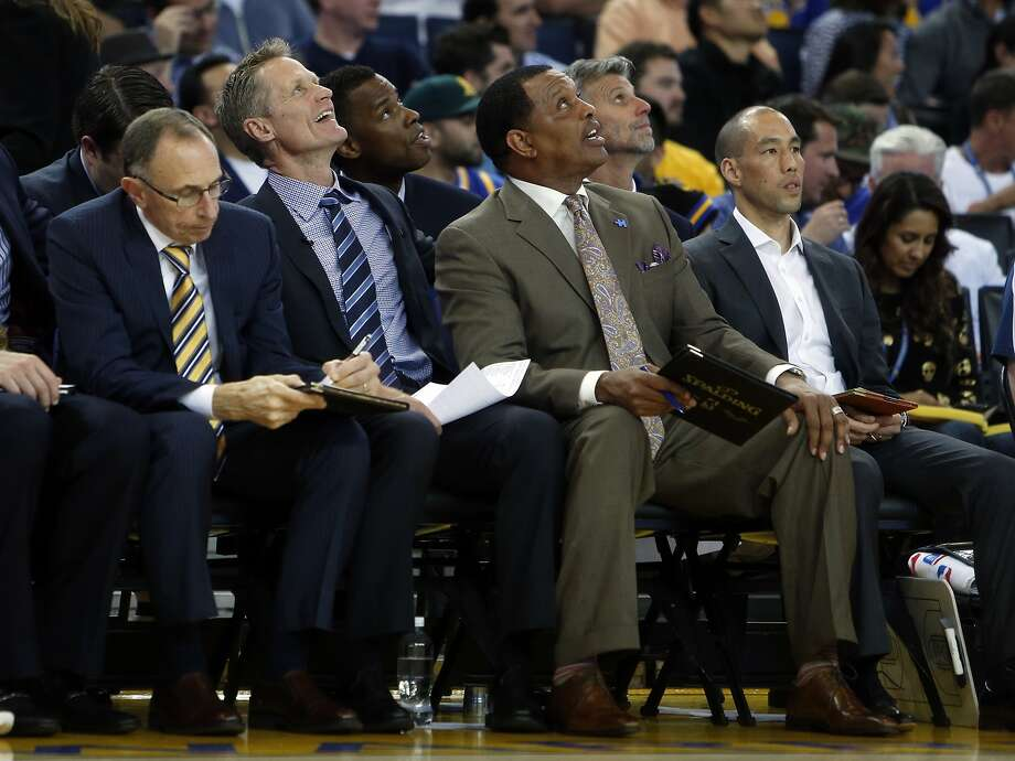 Golden State Warriors' head coach Steve Kerr and assistant coach Alvin Gentry smile while watching a replay in 2nd quarter against Phoenix Suns during NBA game at Oracle Arena in Oakland, Calif., on Thursday, April 2, 2015. Photo: Scott Strazzante, The Chronicle