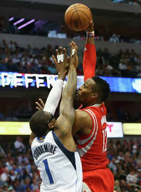 Dwight Howard puts a shot up and over the Mavericks' Amare Stoudemire during the Rockets' 108-101 victory. Photo: Ronald Martinez, Staff / 2015 Getty Images