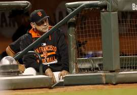 San Francisco Giants manager Bruce Bochy watches as his team trails 7 to 1 during the fourth inning of the baseball game against the Oakland Athletics on Thursday, April 2, 2015 in San Francisco, Calif.