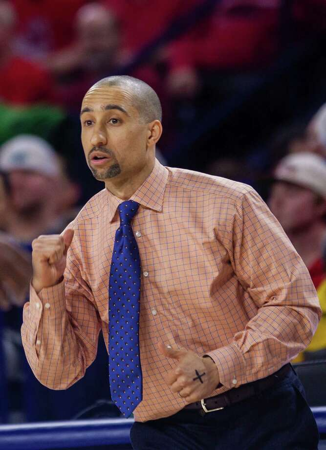 FILE - In this Wednesday, Feb. 25, 2015 file photo, VCU head coach Shaka Smart leads his team during overtime at an NCAA college basketball game at Robins Center in Richmond, Va. Shaka Smart is leaving Virginia Commonwealth to coach the Texas Longhorns. VCU sports information director Scott Day confirmed to reporters gathered at the campus Wednesday night, April 1, 2015 that Smart was making the move. (AP Photo/Zach Gibson, File) Photo: Zach Gibson, FRE / FR170359 AP