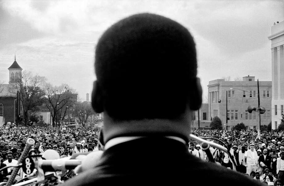 Left: The Rev. Martin Luther King Jr. is seen up close from the rear as he addresses 25,000 civil rights marchers in front of the Alabama state Capitol. Photo: Stephen F. Somerstein / Stephen F. Somerstein / ONLINE_YES