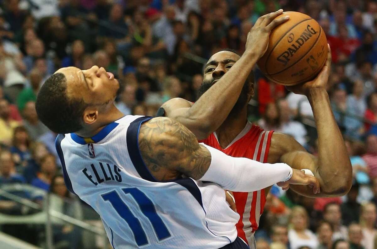 DALLAS, TX - APRIL 02: Monta Ellis #11 of the Dallas Mavericks is fouled by James Harden #13 of the Houston Rockets at American Airlines Center on April 2, 2015 in Dallas, Texas. NOTE TO USER: User expressly acknowledges and agrees that, by downloading and or using this photograph, User is consenting to the terms and conditions of the Getty Images License Agreement. (Photo by Ronald Martinez/Getty Images)