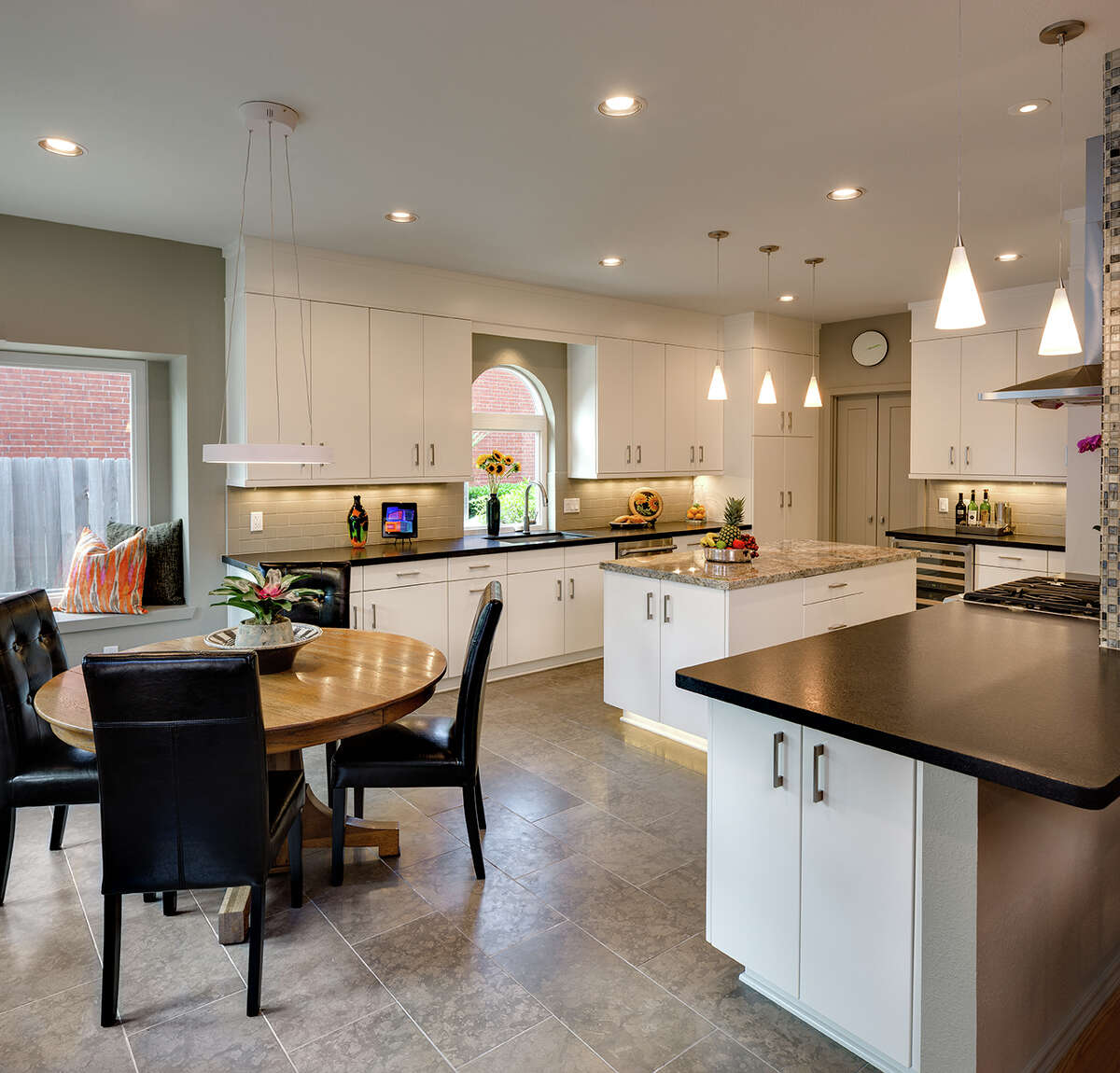 Interior designer Lynne T. Jones, with contractor Jim Nowlin, created this sleek contemporary look for Sugar Land residents Yvette and Bob Menefee. Their earlier kitchen, Yvette said, was a time capsule from the 1990s.