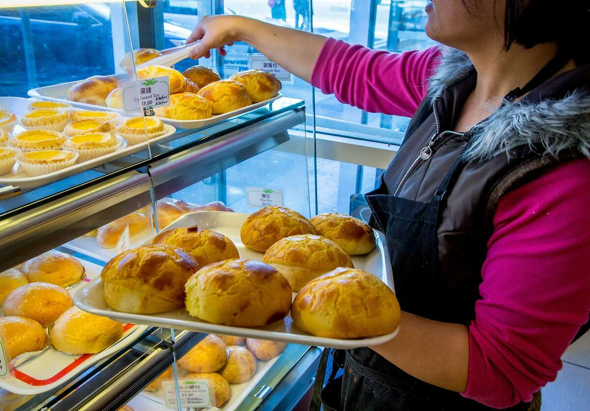 Fresh buns being delivered to the display case at the Pineapple King Bakery in San Francisco, Calif., on Thursday, April 2nd, 2015.