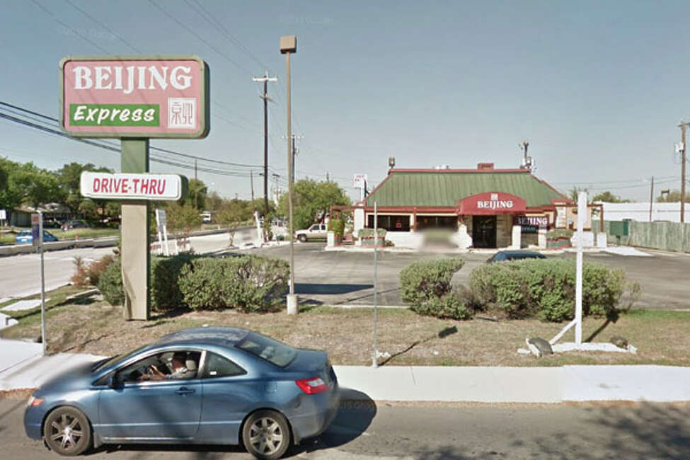Beijing Express: 8003 Marbach Road Date: 12/04/2018 Score: 57 Highlights: Observed ants and flies in the kitchen. A fish fillet and a chunk of meat were lying on the freezer floor. Ventilation system above woks had grease build up and grease dripping from them.