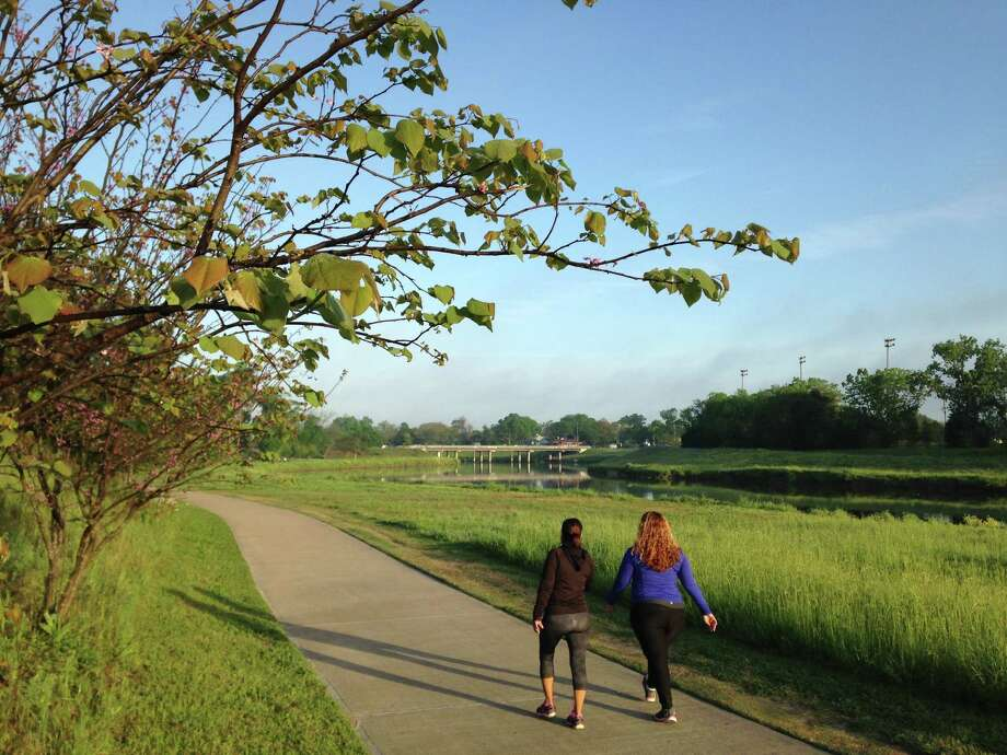 Walkers try out a new stretch of hike and bike trails along Brays Bayou at Mason Park. The trails will eventually span 30 miles. Photo: Molly Glentzer