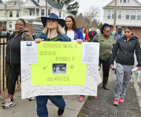 Event organizer Sharron-Linn Schmidt, center with sign, during the Mont Pleasant Good Friday Cross Walk Friday April 3, 2015 in Schenectady, NY.  (John Carl D'Annibale / Times Union) Photo: John Carl D'Annibale / 00031266A