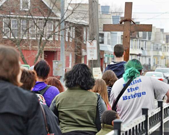Adam Konicki, 16,right, leads the Mont Pleasant Good Friday Cross Walk Friday April 3, 2015 in Schenectady, NY.  (John Carl D'Annibale / Times Union) Photo: John Carl D'Annibale / 00031266A