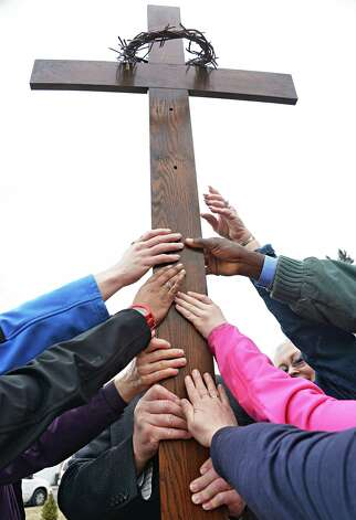 Participants in the Mont Pleasant Good Friday Cross Walk with cross at Holy Name of Jesus Church Friday April 3, 2015 in Schenectady, NY.  (John Carl D'Annibale / Times Union) Photo: John Carl D'Annibale / 00031266A