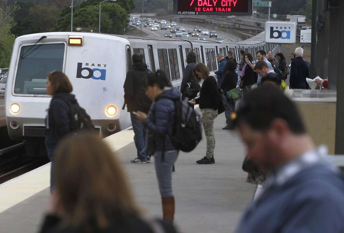 Commuters line up to board a San Francisco train arriving at the Rockridge BART station in Oakland, Calif. on Tuesday, March 24, 2015. Ridership continues to rise on the regional transit system.