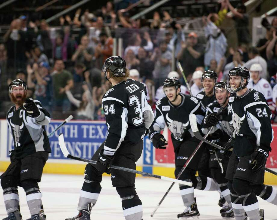 Rampage players and fans celebrate the ninth consecutive victory, a franchise record, Thursday at the AT&T Center. It clinched just the fourth postseason berth in 13 seasons. Photo: Darren Abate /AHL / Darren Abate/DA Media, LLC