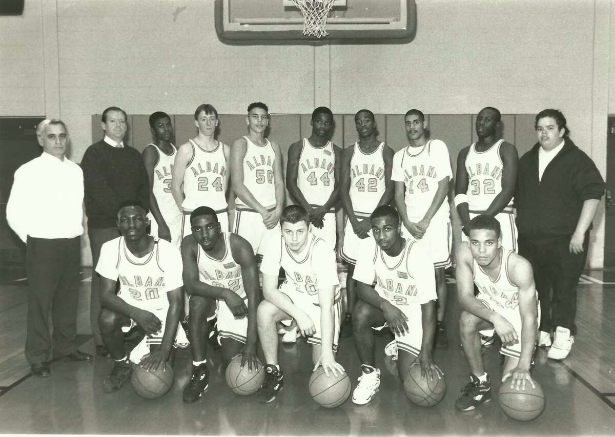 The Albany High School Killer D's basketball team in 1993 that won the Section II tournament. The team also won in 1994 with Dontay Ivy, front row second from right, at point guard. Ivy was killed during a struggle with police on Thursday, April 2, 2015, in Albany, N.Y. (Photo courtesy of Sean Hicks)