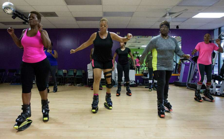 Members of Mia Trevillion's Groove Bounce Fun fitness class perform a workout with Kangoo jumping boots on Tuesday, March 17, 2015, in Houston. The boots provide a bouncy, low-impact workout. Photo: J. Patric Schneider, For The Chronicle / © 2015 Houston Chronicle