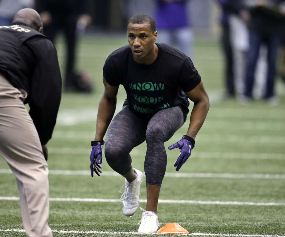 Former Washington player Marcus Peters works out at Washington's pro day Thursday, April 2, 2015, in Seattle.