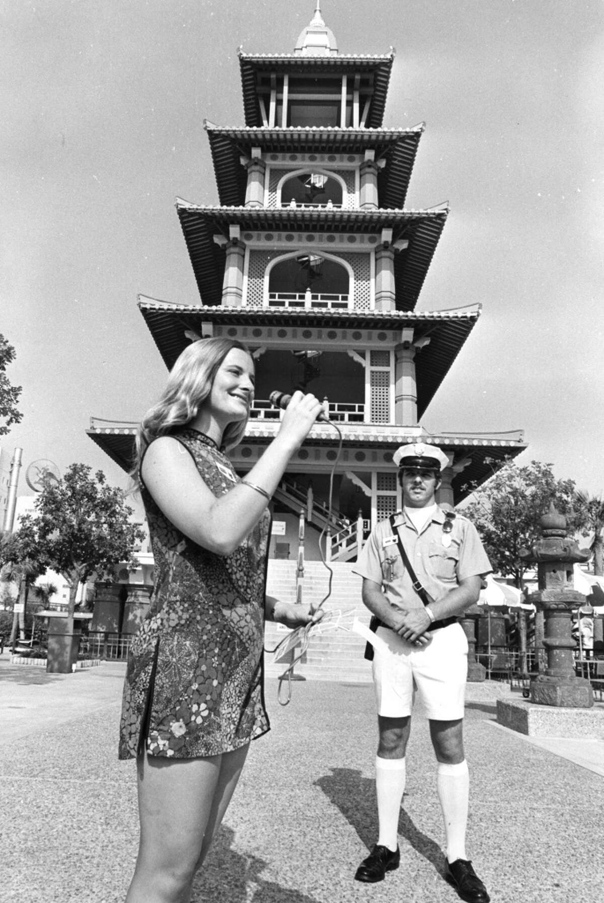 PHOTO FILED: BUSCH GARDENS-HOUSTON. 07/1972 - College students work many of the jobs at Busch Gardens. Security guard Michael McKinney is a Texas Aggie and hostess Sharon Wichlep attends St. Mary's in San Antonio. Orie Collins / Houston Chronicle HOUCHRON CAPTION (07/26/1972): TEXAS AGGIE MICHAEL MCKINNEY IS BUSCH GARDENS SECURITY GUARD. Pretty Gardens Hostess is Sharon Wichlep, Who Attends St. Mary's in San Antonio.