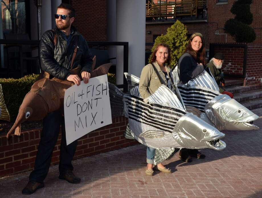 Offshore drilling protesters wearing costumes of fish that reside in Atlantic waters rally against proposed offshore oil and gas development outside a public meeting in March in Annapolis, Md. Photo: Jennifer A. Dlouhy / Houston Chronicle