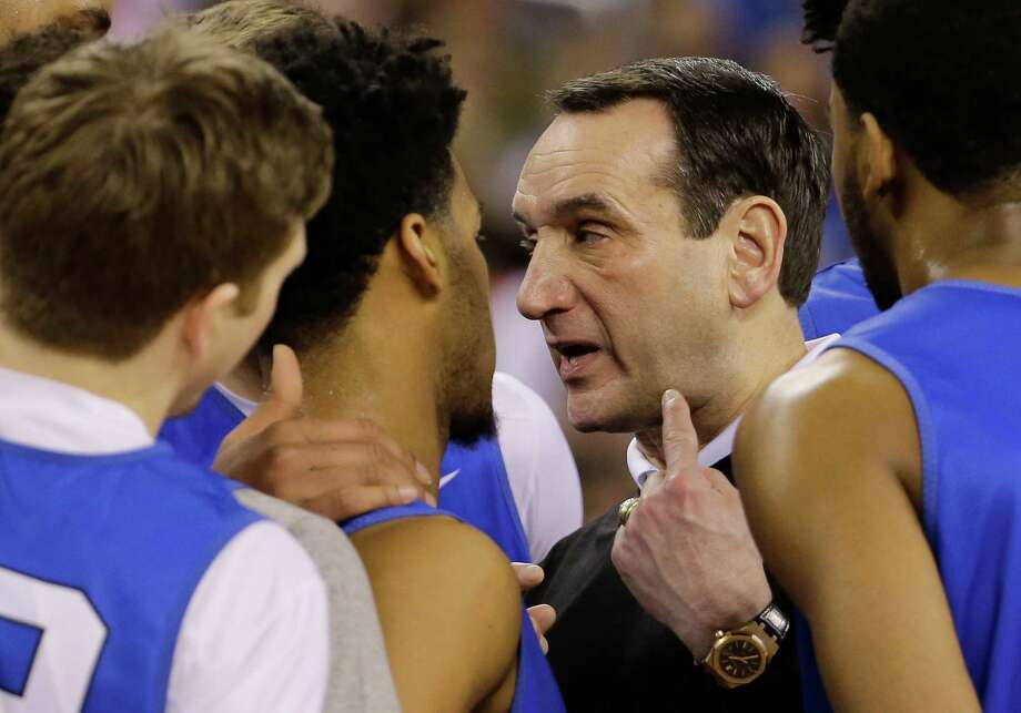Duke head coach Mike Krzyzewski talks to his players during a practice session for the NCAA Final Four semifinal game on April 3, 2015, in Indianapolis. Duke plays Michigan State on Saturday. Photo: David J. Phillip /Associated Press / AP