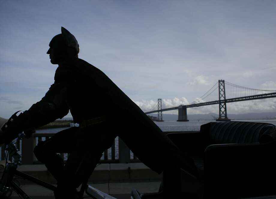 Golden Gate Pedicab driver dressed as Batman, Jorge Olascoaga starts his day on the Embarcadero in San Francisco, Calif. Photo: Mike Kepka, The Chronicle