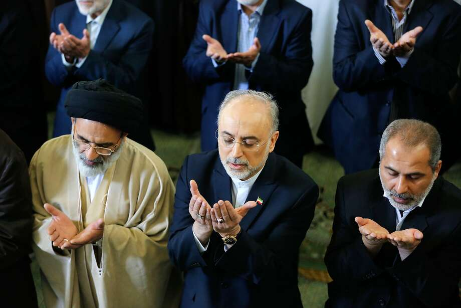 "The Head of the Iranian Atomic Energy Organization Ali Akbar Salehi (C) attends the weekly Friday prayer on April 3, 2015, in the Iranian capital Tehran. Iran vowed to stand by a nuclear deal with world powers as President Hassan Rouhani promised it would open a ""new page"" in the country's global ties. AFP PHOTO/ATTA KENAREATTA KENARE/AFP/Getty Images Photo: Atta Kenare, AFP / Getty Images"