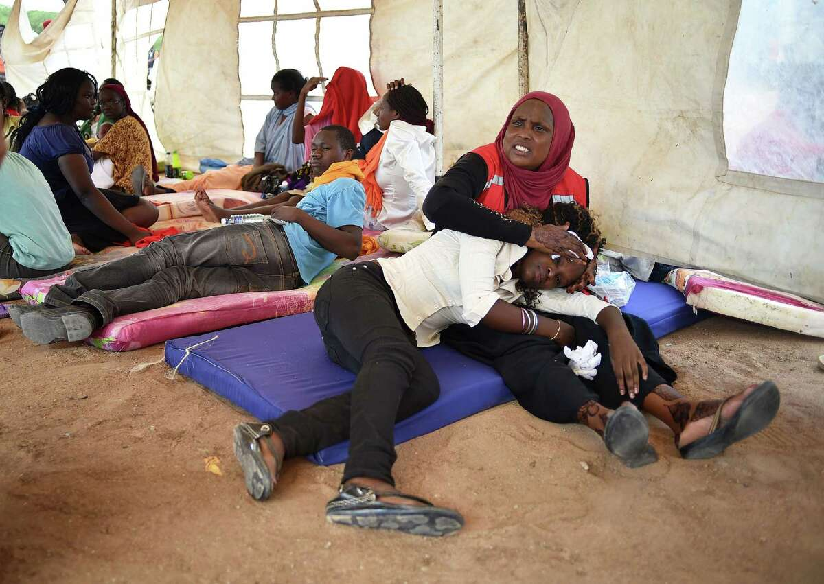 A student evacuated from Moi University during a terrorist seige is treated for shock by a member of the Red-Cross in Garissa.