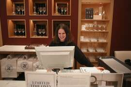 Visual Associate Kathy Judkins does a stock check at the Williams Sonoma flagship store in San Francisco, California on Friday, April 3, 2015.