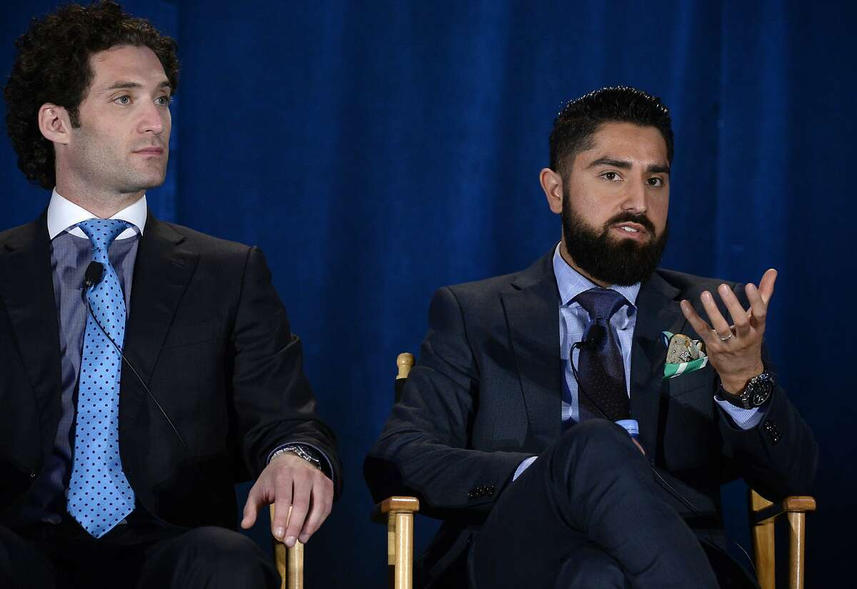 """LOS ANGELES, CA - APRIL 2: Cast members Justin Fichelson (L) and Roh Habibi participate in a panel of """"Million Dollar Listing San Francisco"""" during NBCUniversal Summer Press Day on April 2, 2015 in Pasadena, California. (Photo by Kevork Djansezian/Getty Images)"""